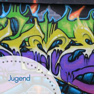 Graffiti in lila, gelb und grün